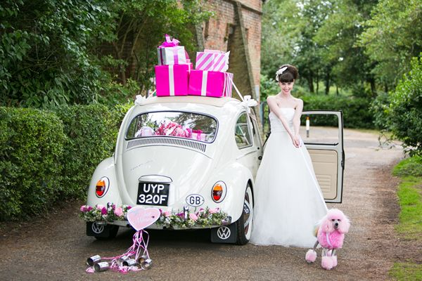 Boutique Blooms, floral design, styling, Polly Pootles the Volkswagen Beetle piled high with pink parcels, a floral adorned bumper, just married sign, ribbon and tin cans.
